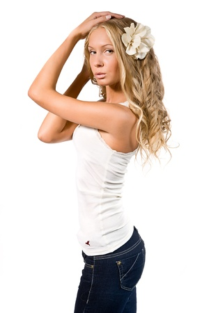 Portrait of the beautiful girl in jeans and with a flower in hair Stock Photo - 12569480