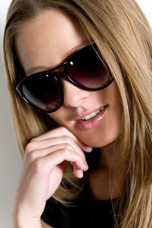 young beautiful brunette wearing spectacles photo