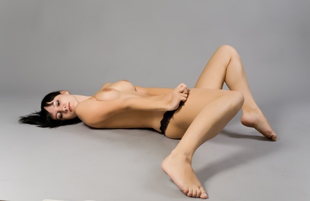 Portrait of the beautiful naked girl with black hair