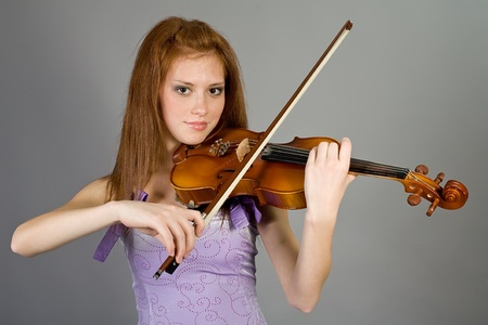 The young attractive girl with a violin Stock Photo - 12740497