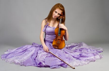 The young attractive girl with a violin