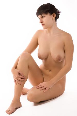femme se deshabille: Portrait de la jeune femme nue