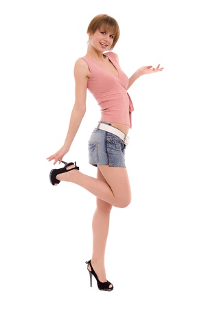 The high long-legged girl in a jeans skirt  isolated on white