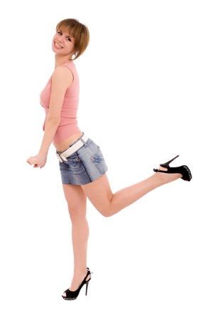 The high long-legged girl in a jeans skirt  isolated on white photo