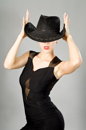 attractive female: Portrait of the young girl in an elegant black dress and a hat
