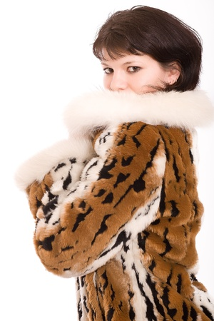 girl in a brown fur fur coat  isolated on white photo