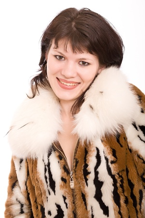 peltry: girl in a brown fur fur coat  isolated on white