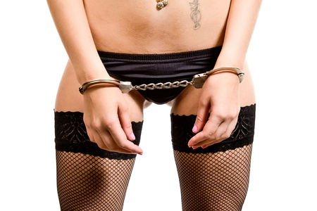attractive woman in black linen and handcuffs Stock Photo - 12994759