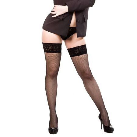 young woman in stockings and a black jacket  isolated on white Stock Photo - 12991548