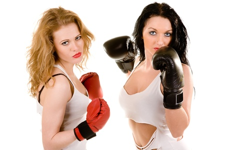 two attractive woman in boxing gloves  Isolated on white photo