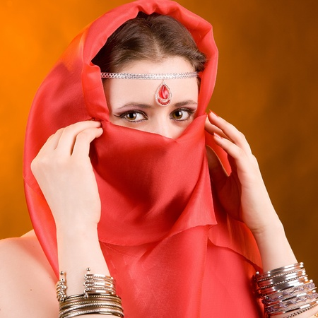 silk scarf: Portrait of the woman in a red scarf Stock Photo