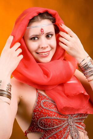 Portrait of the woman in a red scarf Stock Photo - 13232926