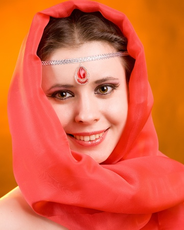 Portrait of the woman in a red scarf photo