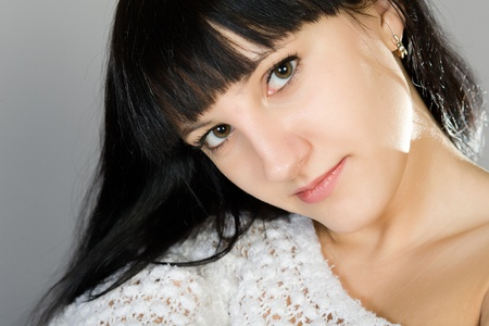young beautiful brunette in a white blouse Stock Photo - 13517248