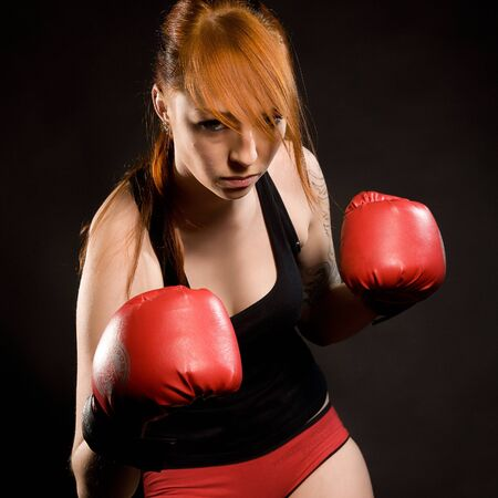 violence in sports: young attractive woman the boxer on training