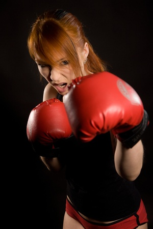brutal: young attractive woman the boxer on training