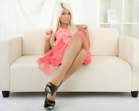 Attractive girl sitting on the sofa photo