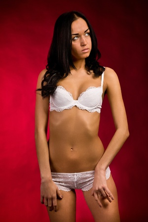 girl in white lingerie on a red background Stock Photo - 16299658