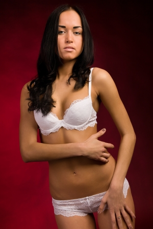 girl in white lingerie on a red background Stock Photo - 16299664