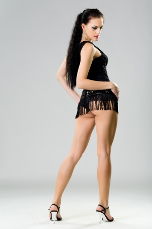 beautiful girl in a black dress photo