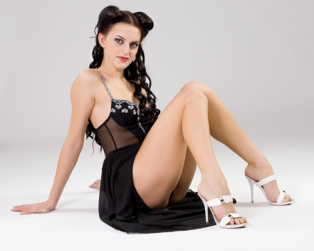 beautiful young woman in a black evening dress