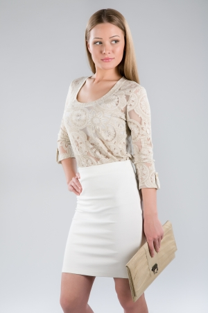 Attractive young woman in a beautiful dress