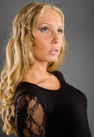 Beautiful girl with long hair in black dress photo
