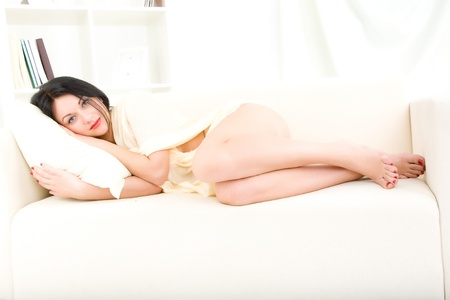 young beautiful woman sleeping on the couch photo