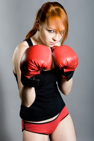 female boxer: young attractive woman the boxer on training