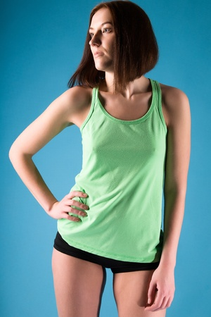 attractive young brunette in a green shirt photo