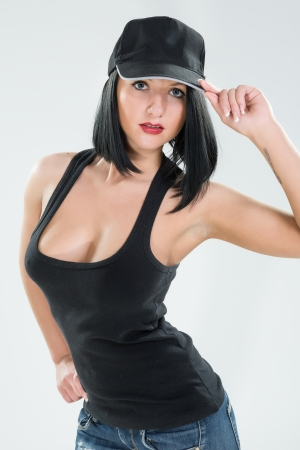 black cap: sexy brunette in a black cap and shirt