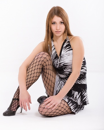 Young beautiful woman in mesh stockings photo