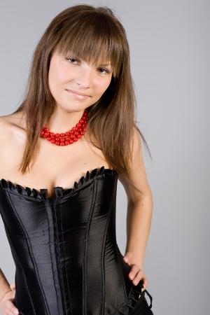 belonging to the caucasoid race: attractive girl in a black corset