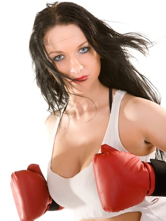 attractive woman in boxing gloves  Isolated on white photo