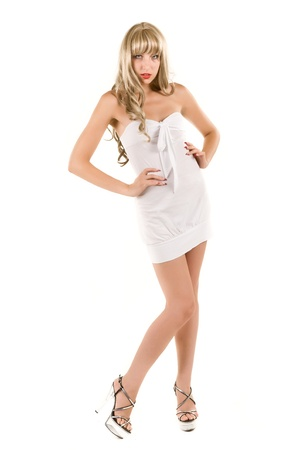 teenage girl dress: attractive blonde in a white dress