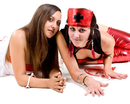 two attractive girls dressed as nurses photo