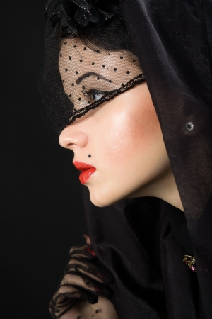 young beautiful woman in a black veil Stock Photo