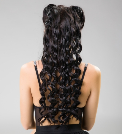 beautiful wavy hair on female back photo