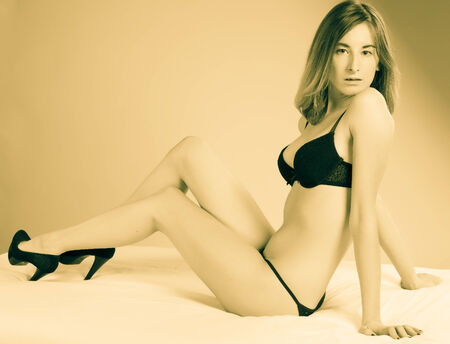 young attractive woman in beautiful black lingerie photo