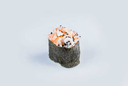 Japanese Gunkan Ebi Sushi with flying fish roe. Gunkan-poppy with Tobiko caviar, rice and black tiger shrimp wrapped in nori seaweed. Side view Pan Asian dish Gunkan Maki isolated on gray background