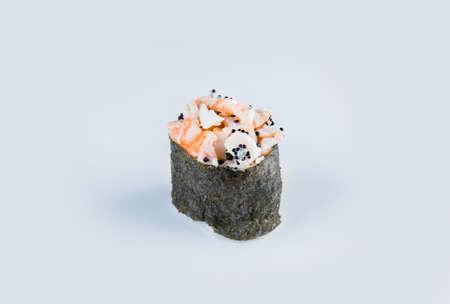 Japanese Gunkan Ebi Sushi with flying fish roe. Gunkan-poppy with Tobiko caviar, rice and black tiger shrimp wrapped in nori seaweed. Side view Pan Asian dish Gunkan Maki isolated on gray background Stock fotó
