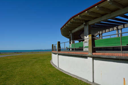 Pavilion by the sea , green benches sea view pergola ocean pathway art deco bench