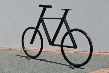 Bike stand sculpture bicycle parking graphic city metal green wall , bike symbol Stock Photo