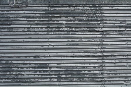 galvanized corrugated metal sheet with rivets pattern background peeling paint industrial texture weathered Stock Photo