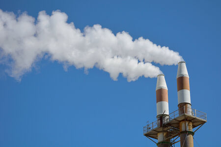 Factory smokestacks polluting the sky