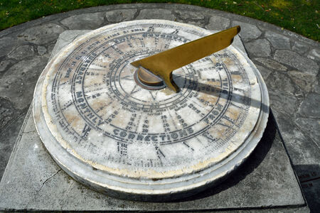 Vintage sundial made of brass and marble.
