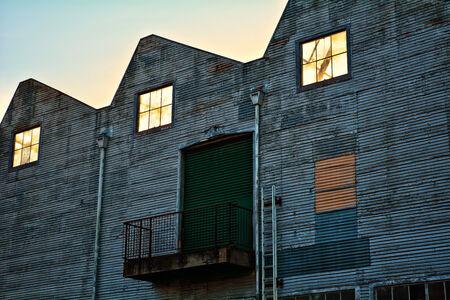 Large abandoned, rusty old warehouse.