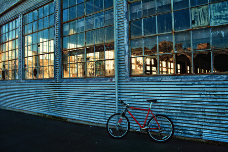 Bike leaning up against old factory