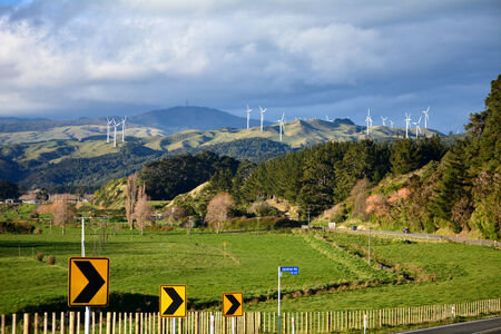 Wind turbines on hills. Clean energy power generation farm.