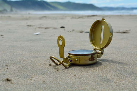 compass at ground level on the beach Stock Photo